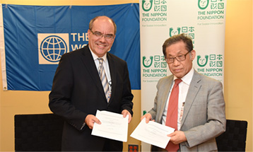 Photo of agreements signed by the World Bank and The Nippon Foundation to support job training and employment for persons with disabilities